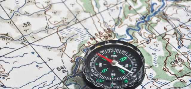Using a map and a compass are important survival skills.